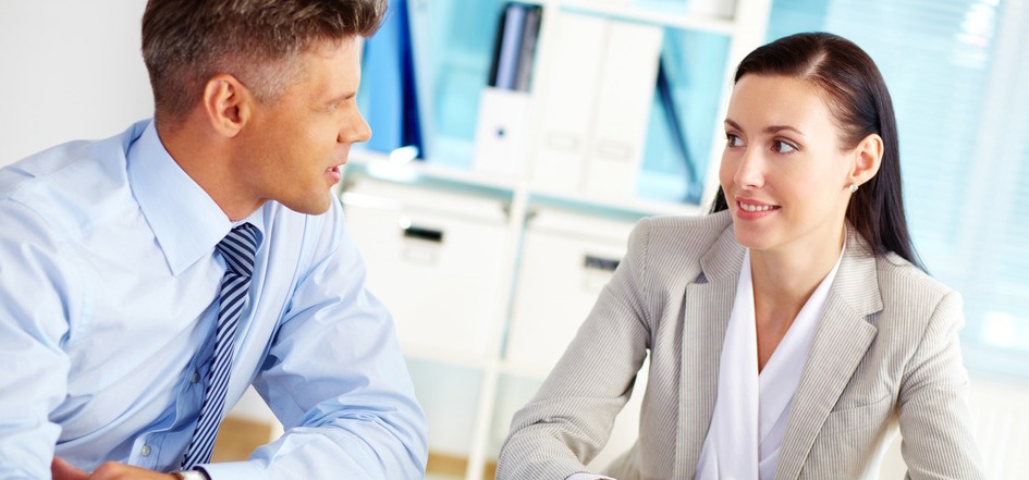 Successful business people talking about the terms of their business relationship